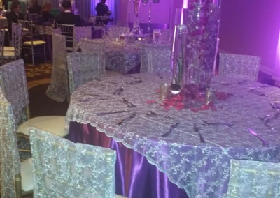 Purple satin table cloth with lace overlay