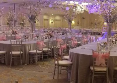Silver chiavari chairs with pink organza chair sashes
