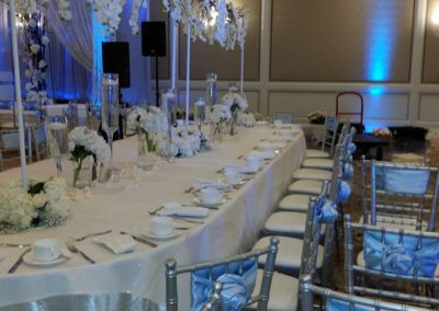 Silver chiavari chairs with silver satin sashes