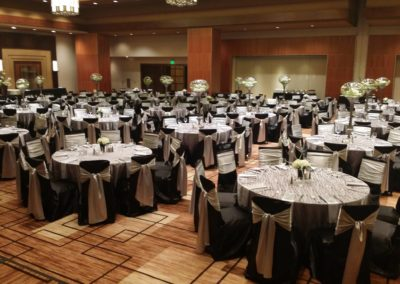 Black polyester chair covers with silver satin chair sashes