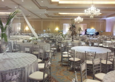 Silver chiavari chairs and white lace sequin overlays