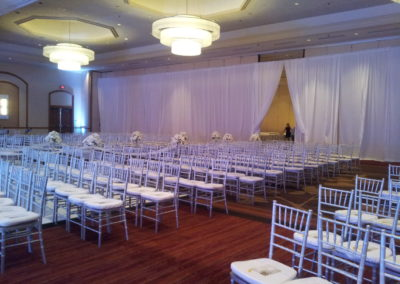 Silver chiavari chairs with white cushions