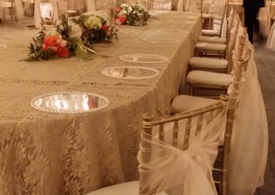 Floral print overlay and gold chiavari chairs