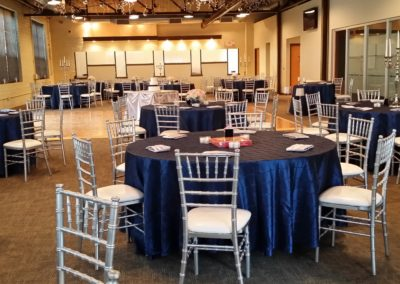 Silver chiavari chairs and navy pintuck tablecloth