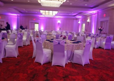 White spandex chair covers with white spandex sashes and blue sequin band