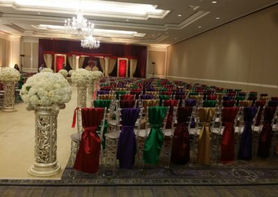 Silver Chiavari chairs with colored sashes