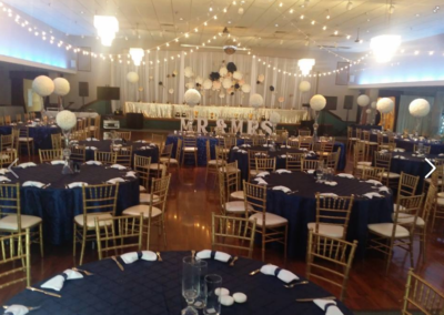Navy tablecloth with gold chiavari chairs