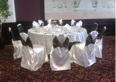 White satin chair covers with Chocolate satin chair ties and White lace overlay