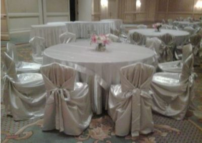 Silver self-tie chair covers and silver satin underlay with Silver organza overlay
