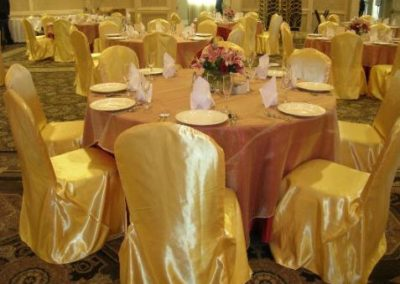 Gold Chair cover and Red satin underlay w/ Gold Organza overlay