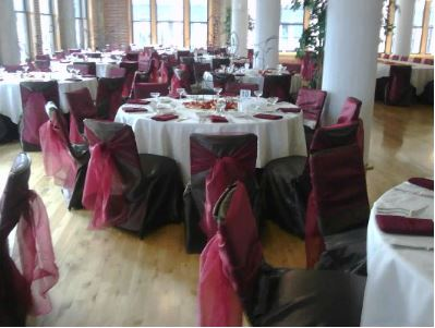 Chocolate satin chair covers with Apple red satin chair ties and Ivory poly overlay