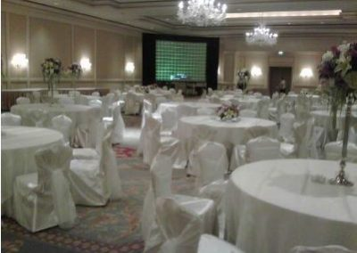 Ivory satin chair covers with Ivory organza chair ties and Ivory satin underlay with organza overlays