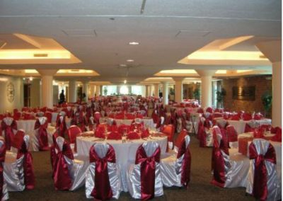 White chair with apple red satin chair tie