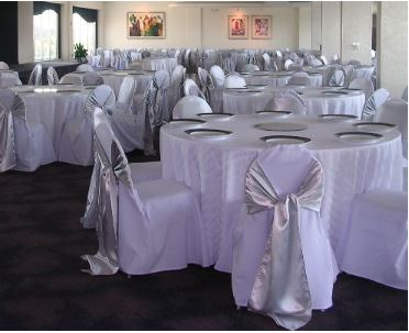 White chair covers with silver satin sash