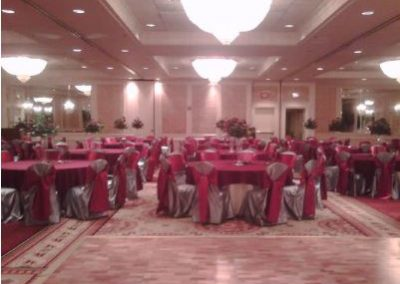 Silver satin chair covers with Apple red satin chair ties and Apple red poly overlay