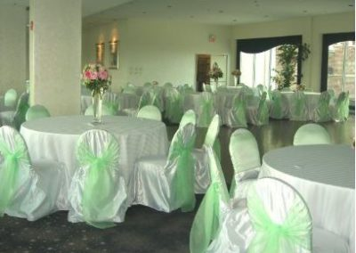 White chair cover with Mint Green organza sash