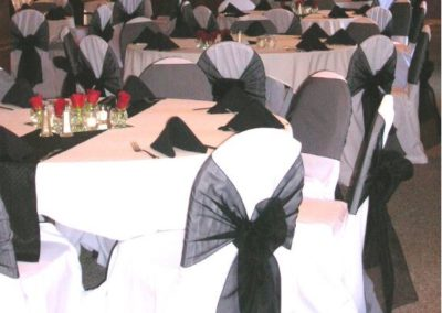 White chair cover with Black Organza chair ties