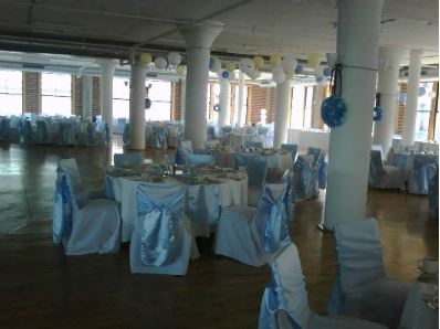 White satin chair cover with baby blue satin chair tie
