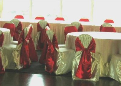White satin chair cover with Red satin chair ties