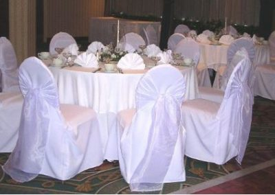 White chair w/ White Frosted Organza sash