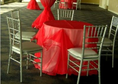 Red organza overlay with red sash