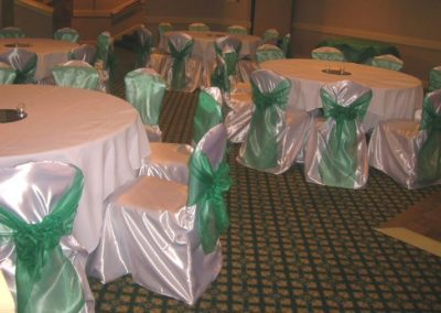 White satin chair covers with Emerald green chair ties