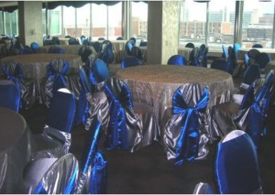 Silver beaded overlay and Silver satin chair covers w/Blue chair ties