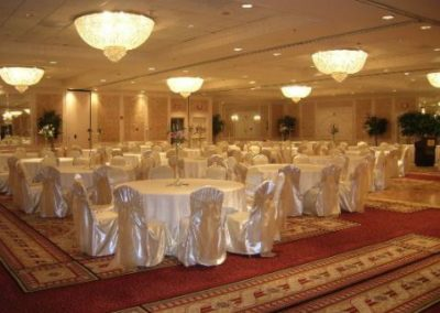 Ivory satin chair cover with Champagne organza chair tie
