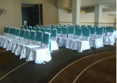 White satin chair covers with Tiffany blue satin chair ties