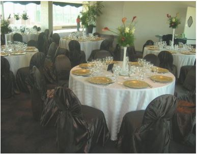 Chocolate satin chair covers with chocolate organza sash