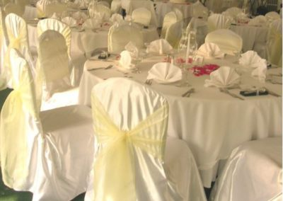 White satin chair cover with Pastel yellow organza sash
