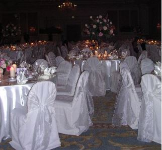 Ivory chair cover w/ Ivory frosted Organza sash