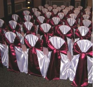 White satin chair cover with Cranberry sash