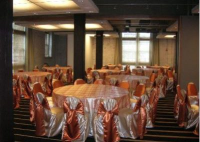 Ivory chair cover with Burnt orange chair tie and Plaid sheer overlay