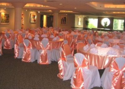 White chair covers w/ Peach chair ties and Satin overlays