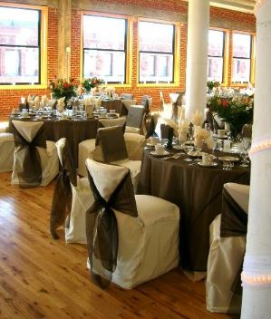 Chocolate organza overlay and Ivory poly chair covers with organza sash