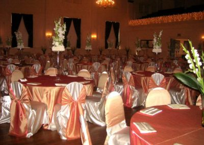Ivory satin chair cover w/ harvest orange chair tie and floor length tablecloth