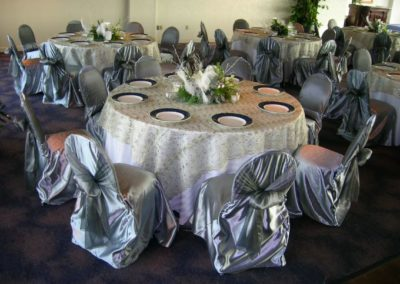 Silver beaded overlay and Silver satin chair covers w/Silver organza chair ties