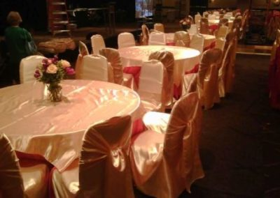 Yellow satin chair covers with Hot pink satin chair ties and Yellow satin tablecloths