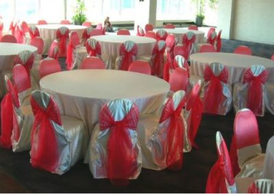White satin chair covers with Red organza chair ties