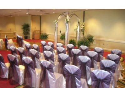White satin chair cover with Eggplant organza chair tie