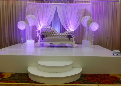 Purple uplighting and champagne chaise