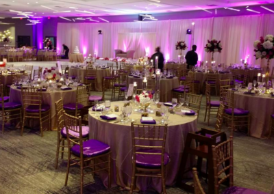 Gold chiavari with purple satin cushion covers