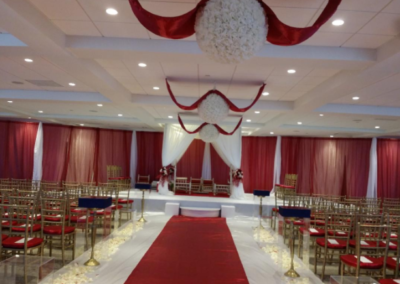 Gold chiavari with red satin cushion cover
